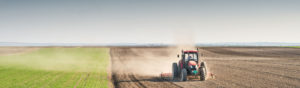A Tractor plowing an Ontario field