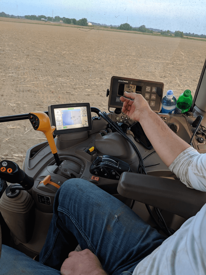 A modern John Deere tractor using GPS guidance technology, seed monitoring systems and variable rate fertilizer application.