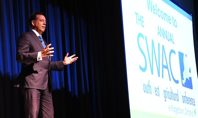 Tom Deans, author of a book on an alternative way of looking at succession planning, speaks at the SouthWest Agricultural Conference at Ridgetown District Secondary School on Jan. 7. Tom Morrison/Chatham This Week